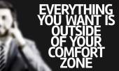 Business man with the text Everything You Want is Outside of Your Comfort Zone — Foto de Stock