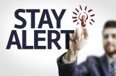 Board with text: Stay Alert — Stock Photo