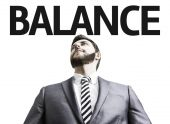 Business man with the text Balance — Stock Photo