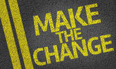 Make the Change written on the road — Stock Photo
