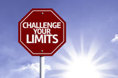 Challenge your Limits written on red road sign — Stock Photo