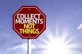 Collect Moments Not Things written on red road sign — Stockfoto