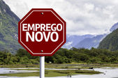 New Job (In Portuguese) written on red road sign — Stock Photo