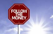 Follow the Money written on red road sign — Stock Photo