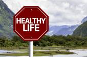 Healthy Life written on red road sign — Stock Photo