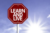 Learn And Live written on red road sign — Stock Photo