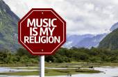 Music Is My Religion written on red road sign — Stock Photo