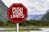 Push your Limits! written on red road sign — Stock Photo