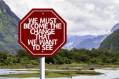 We Must Become The Change That We Want to See written on red road sign — Stock Photo