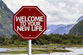 Welcome To Your New Life written on red road sign — Stock fotografie