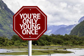 You're Only Young Once written on red road sign — Stock Photo