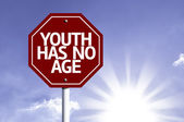 Youth Has No Age written on red road sign — Stock Photo