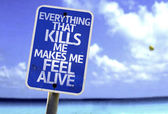 Everything That Kills Me Makes Me Feel Alive sign — Stock Photo