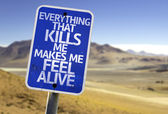 Everything That Kills Me Makes Me Feel Alive sign — Foto de Stock