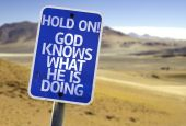 Hold On! God Knows What He is Doing sign — Stock Photo