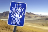 It's Scary What a Smile Can Hide sign — Stock Photo