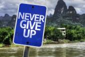 Never Give Up sign — Stock Photo