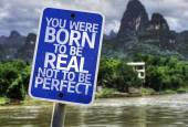 You Were Born To Be Real Not To Be Perfect sign — Stock Photo