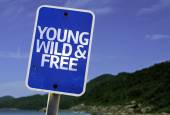 Young Wild & Free sign — Stock Photo