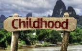 Childhood sign against blue sky — Stockfoto