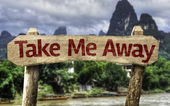 Take me Away sign with a forest — Stock Photo