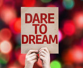 Dare To Dream card with defocused lights — Stock Photo