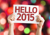 Hello 2015 card with colorful background with defocused lights — Stock Photo