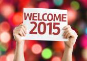 Welcome 2015 card with colorful background with defocused lights — Stock Photo