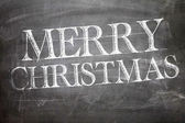 Merry Christmas on blackboard — Stock Photo