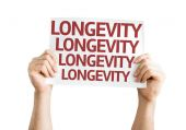 Longevity card in hands — Stock Photo