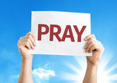Pray card in hands — Stock Photo