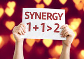 Synergy one plus one equals two card — Stock Photo