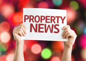 Property News card with colorful background — Stock Photo