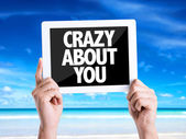 Tablet pc with text Crazy About You — Stock Photo