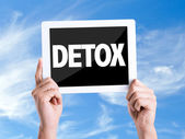 Tablet pc with text Detox — Stock Photo