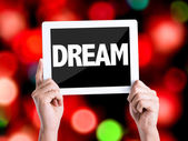Tablet pc with text Dream — Stock Photo
