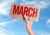 March card in hand — Stock Photo