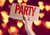Party card in hand — Stock Photo