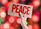 Peace card in hand — Stock Photo