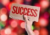 Éxito de la tarjeta en la mano — Foto de Stock