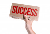 Success card In hand — Stock Photo