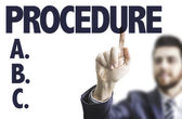 Man pointing the text: Procedure — Stock Photo
