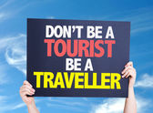 Don't be a Tourist Be a Traveller card — Stock fotografie
