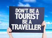 Don't be a Tourist Be a Traveller card — Stock Photo