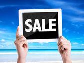 Tablet pc with text Sale — Stock Photo