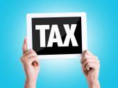 Tablet pc with text :Tax — Stock Photo