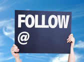 Follow with a copy space card — Stock Photo