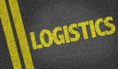 Logistics written on the road — Stock Photo