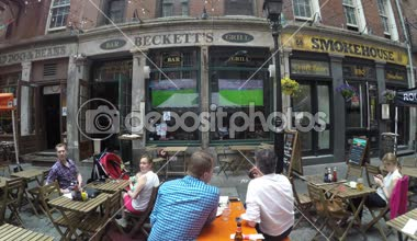 Guys watching soccer in a pub — Stock Video