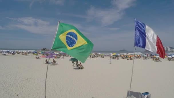 Kiosk beach with Brazil and France flag — Vídeo de stock